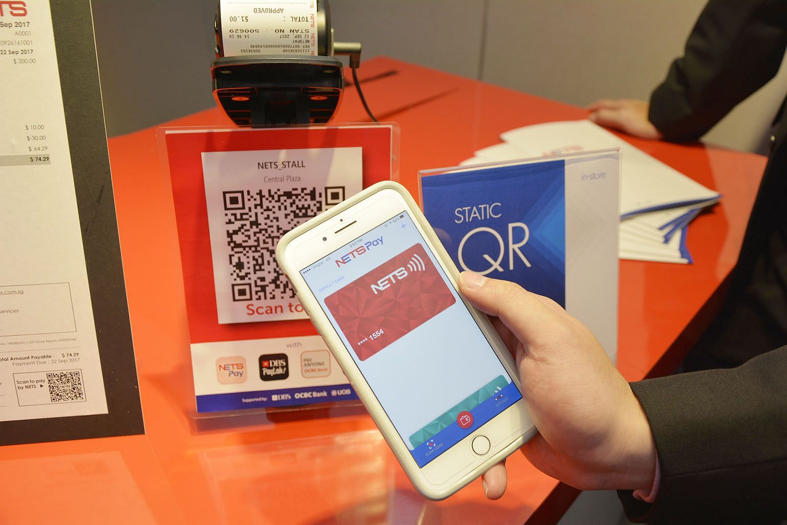 NetsPay lets users digitise their ATM cards, so payments can be debited directly from their bank accounts by tapping their mobile phones on a contactless payment reader or by scanning a QR code.