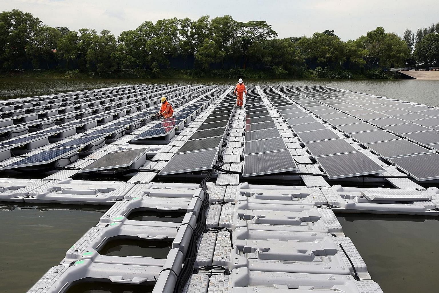 The floating solar panel test bed at Tengeh Reservoir was launched last year to study different photovoltaic systems. Solar energy is important to Singapore since other forms of renewable energy are not as viable here.
