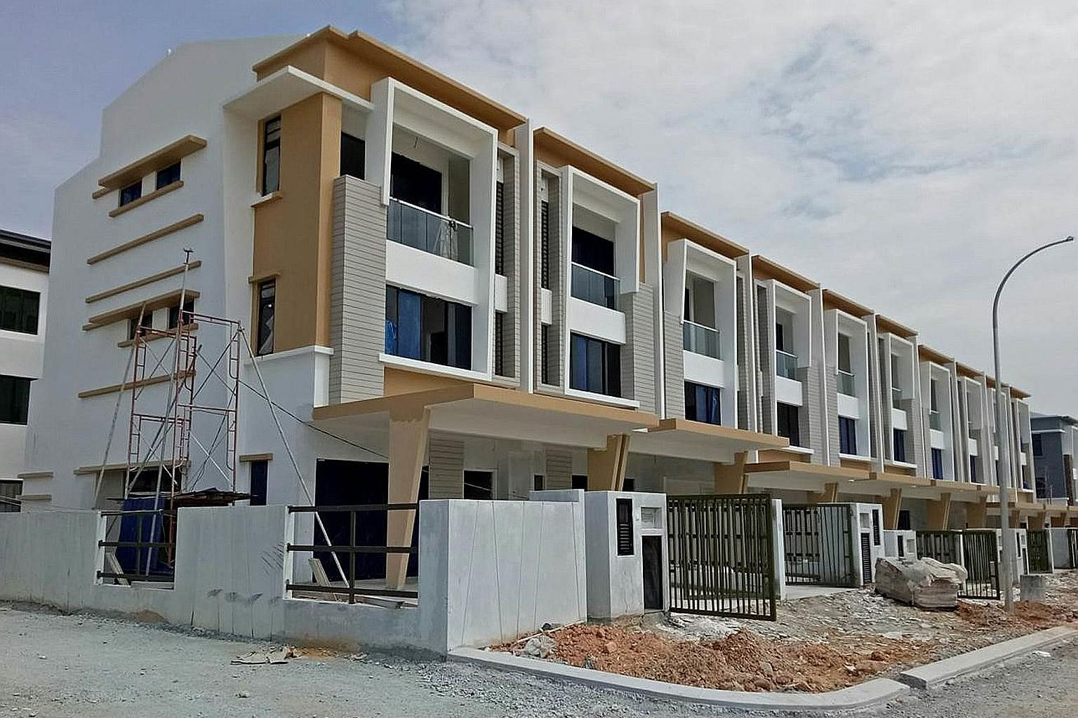 New terrace houses in a Shah Alam development. They are priced from RM891,000 (S$290,000) each.