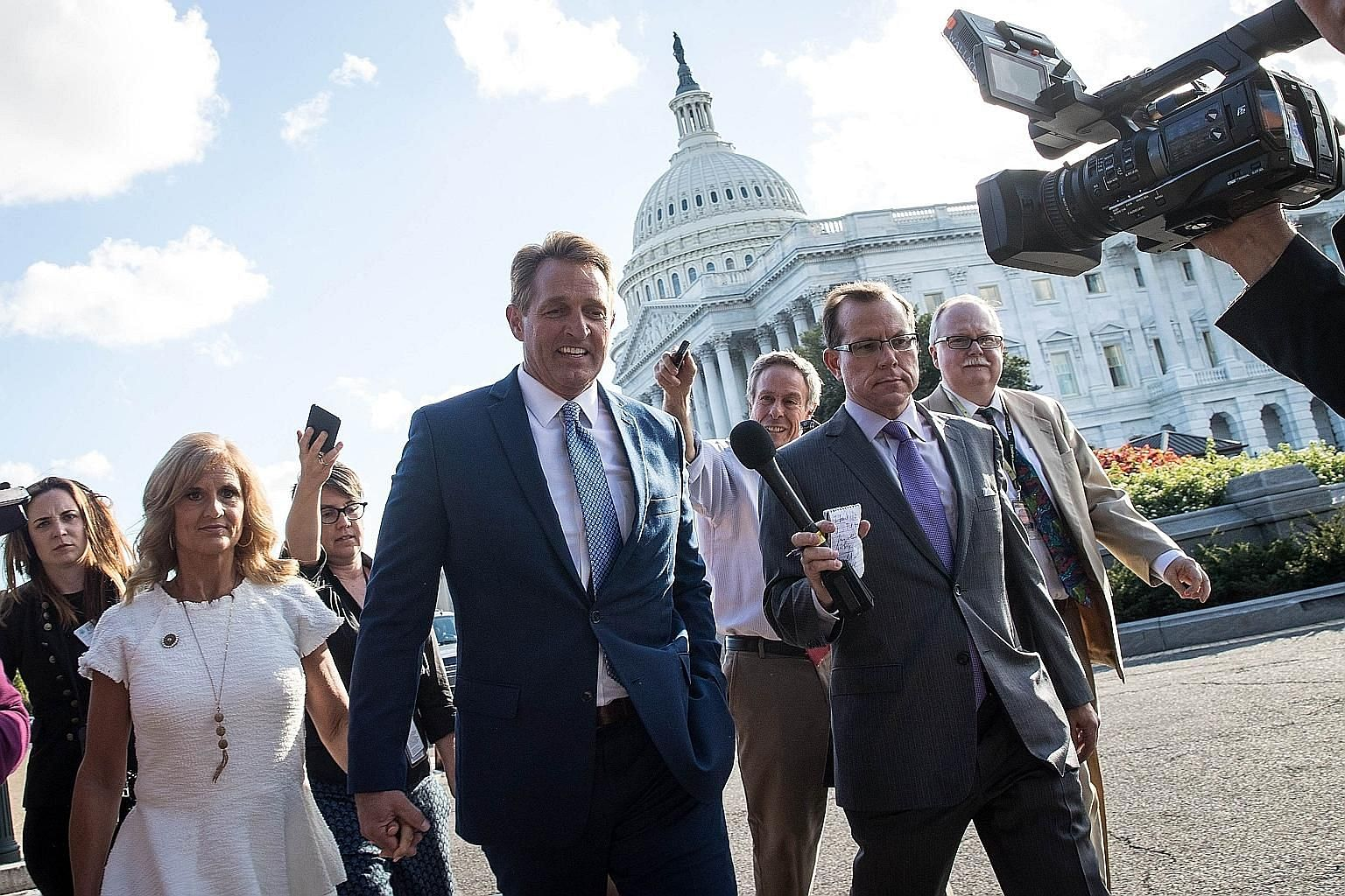 Left: Senator Jeff Flake and his wife, Cheryl, leaving the US Capitol on Tuesday after he announced he would not be seeking re-election. Above: Senator Bob Corker renewed his attack on and war of words with President Donald Trump.