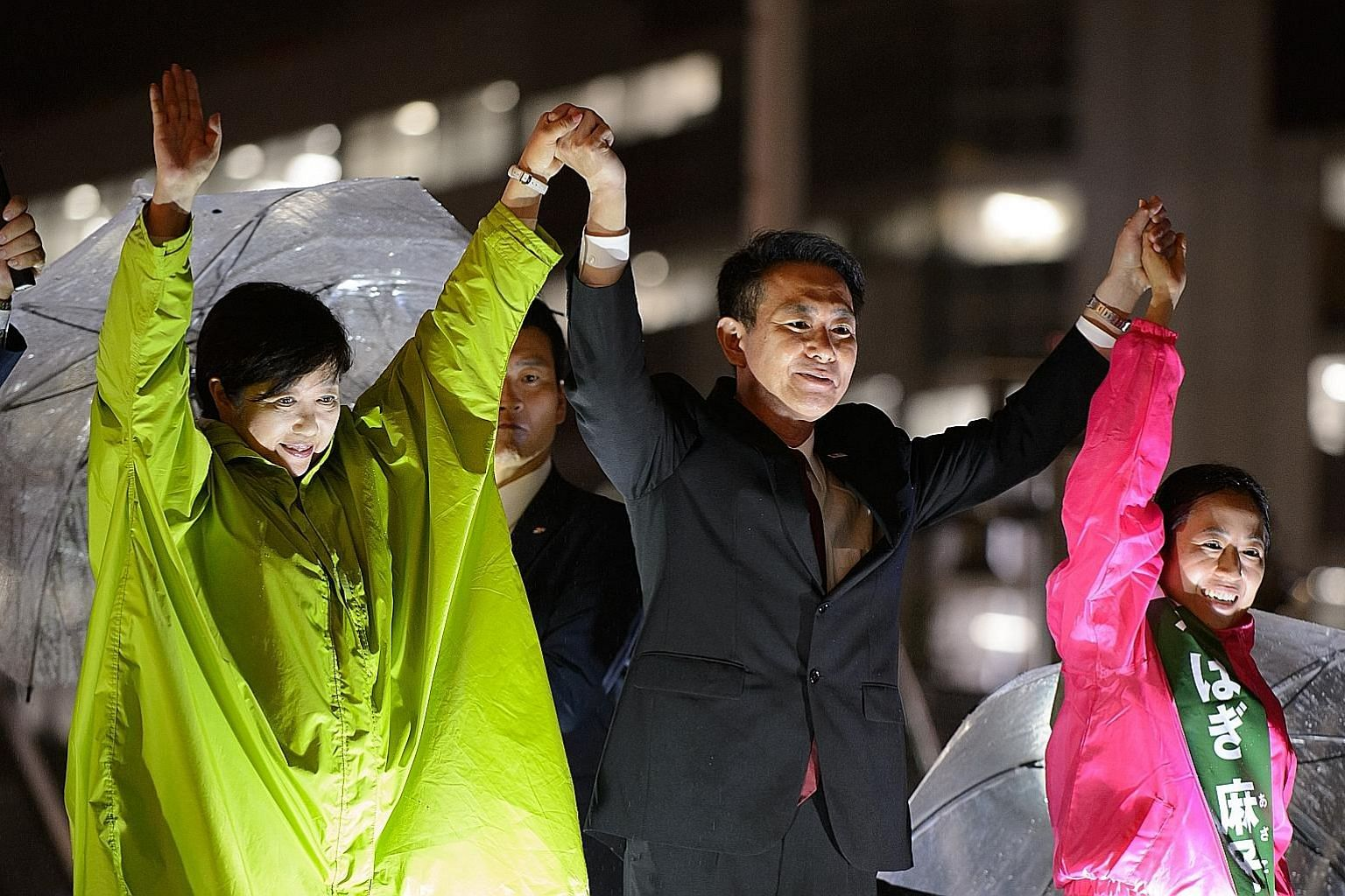 Kibo no To leader, Tokyo Governor Yuriko Koike (in green), with Mr Seiji Maehara, leader of the Democratic Party, at an election rally last week.