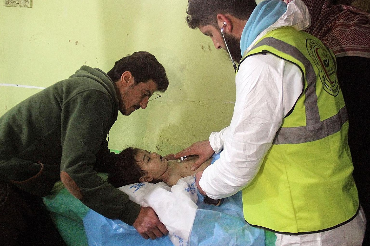 A file photo taken on April 4 showing an unconscious Syrian child receiving treatment at a hospital in Khan Sheikhun, following a suspected toxic gas attack.