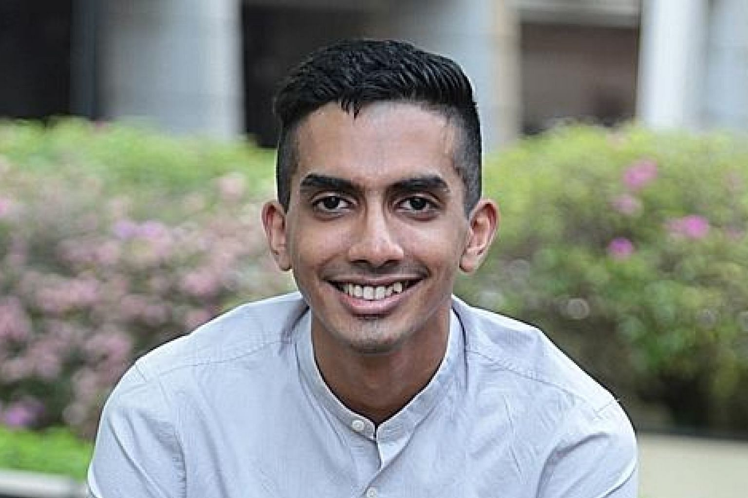 Mr Yudhishthra Nathan started volunteering with the Workers' Party while doing NS and says he was raised to be politically aware, with his father and grandfather taking him to political rallies when he was younger.