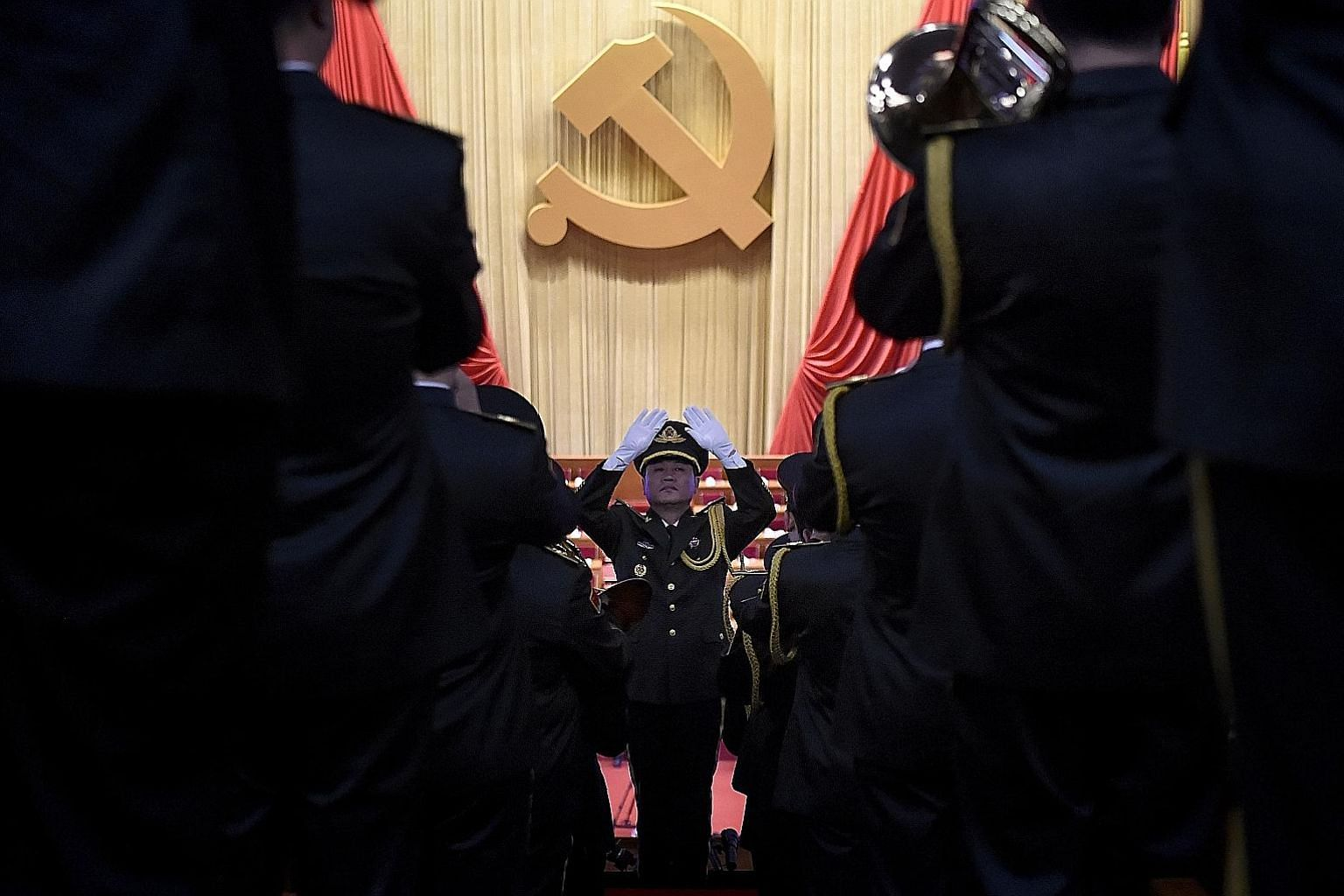A military band practising before the opening session of the Chinese Communist Party's 19th National Congress at the Great Hall of the People in Beijing. While observers say China's aspirations are understandable, there are those who worry about what