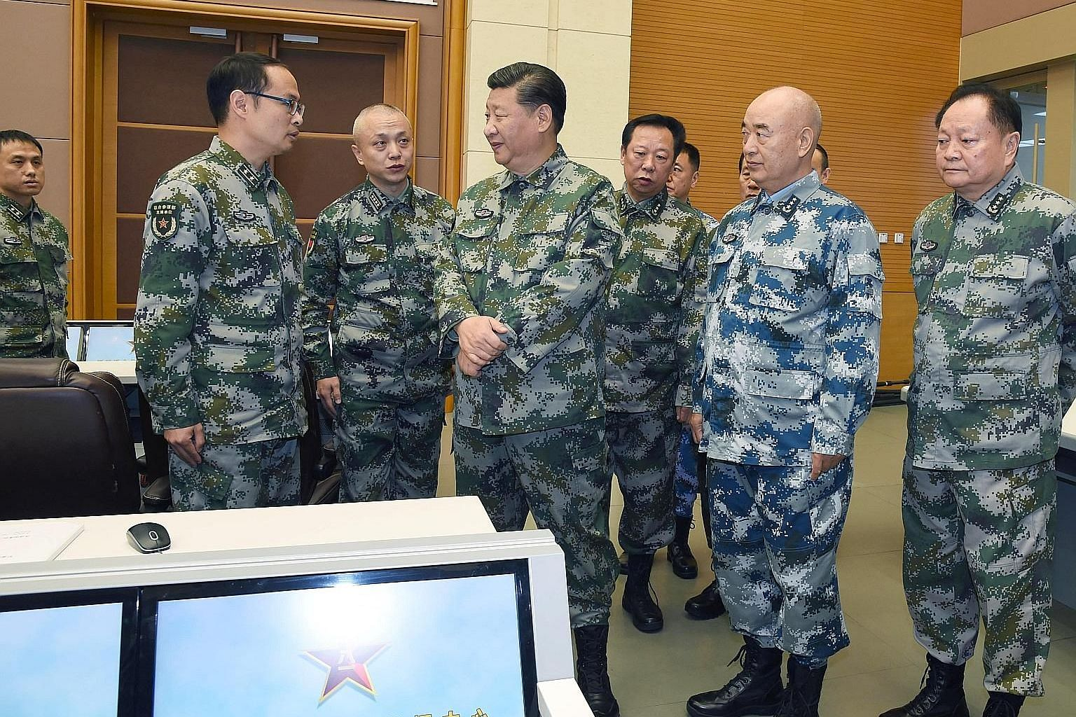 "Chinese President Xi Jinping (centre), who is also chairman of the Central Military Commission, visiting a joint battle command centre in Beijing last Friday, where he issued a directive to the People's Liberation Army high command to ""work hard at c"