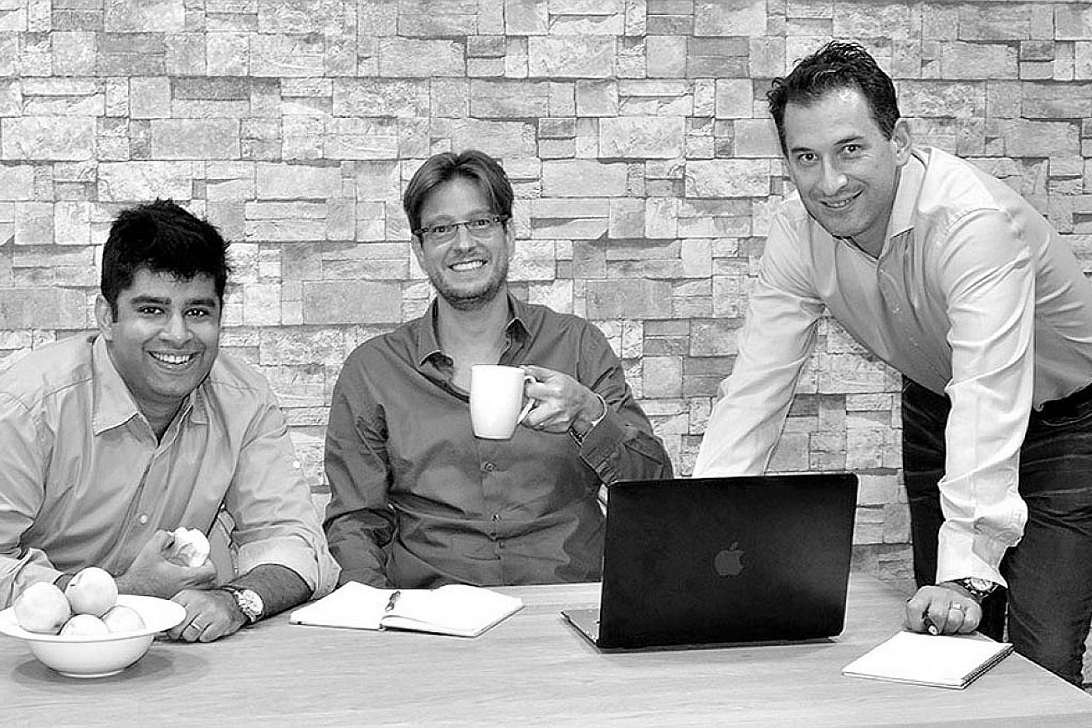 Smartkarma co-founders (from far left) Raghav Kapoor, Jon Foster and Lee Mitchell. The firm said the Series B round of financing brings its total funding to US$21 million (S$28.6 million).