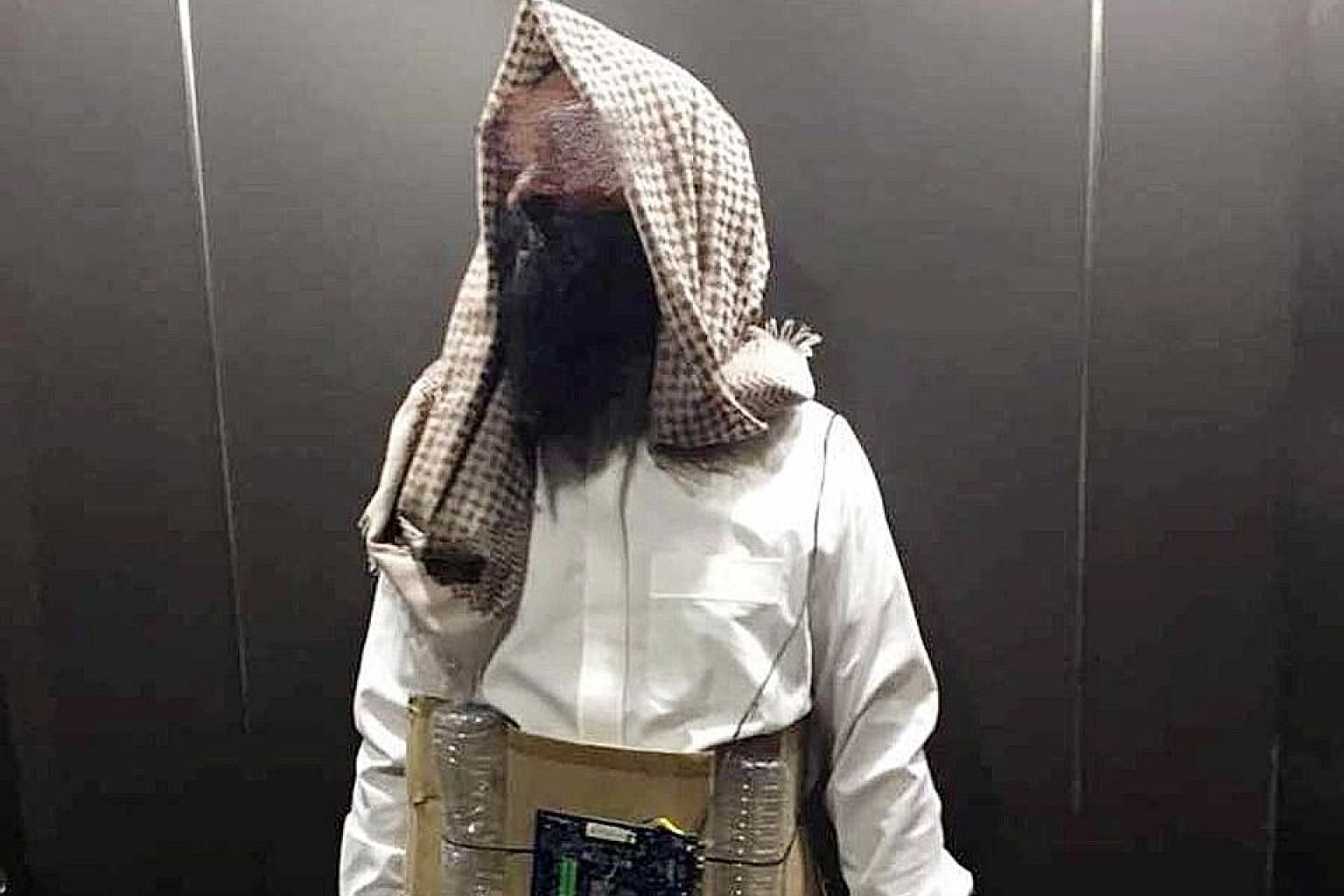 The man, dressed in his costume, was seen in a lift in a Petaling Jaya building.