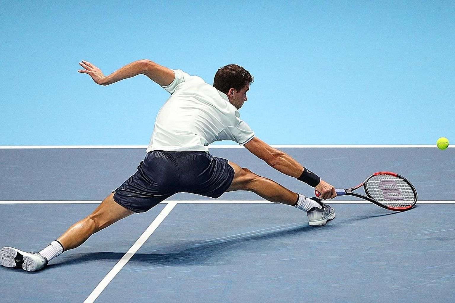 Bulgaria's Grigor Dimitrov in action against Belgian David Goffin on Wednesday. The world No. 6, who has enjoyed the best year of his career with three titles and a last-four place at the Australian Open, will be in the semi-finals of the ATP Finals
