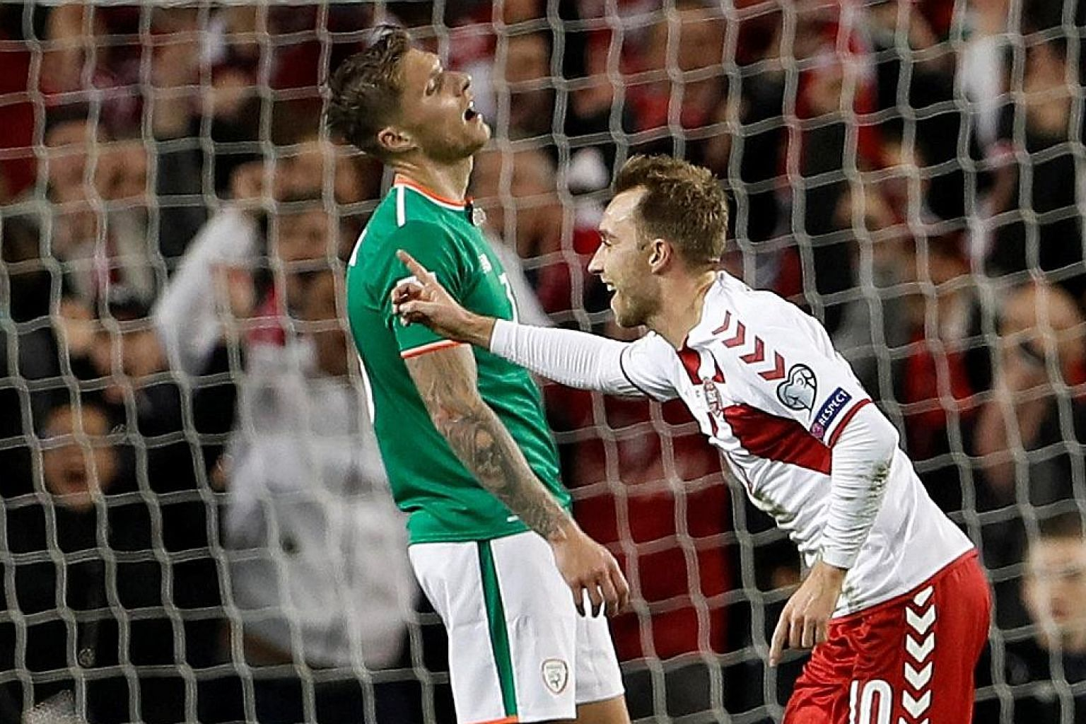 Denmark's delight is the Republic of Ireland's despair, as Christian Eriksen celebrates scoring their fourth goal to complete his hat-trick in the Danes' 5-1 victory in the World Cup play-off on Tuesday.