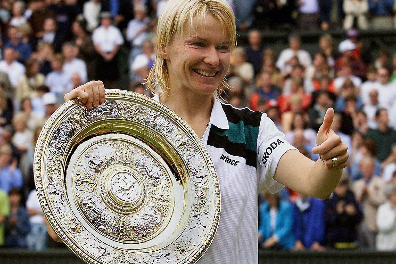 Jana Novotna shows her delight after winning the Wimbledon singles final against Nathalie Tauziat in 1998. Her dramatic loss to Steffi Graf in the 1993 final was followed by a loss to Martina Hingis in the 1997 final.