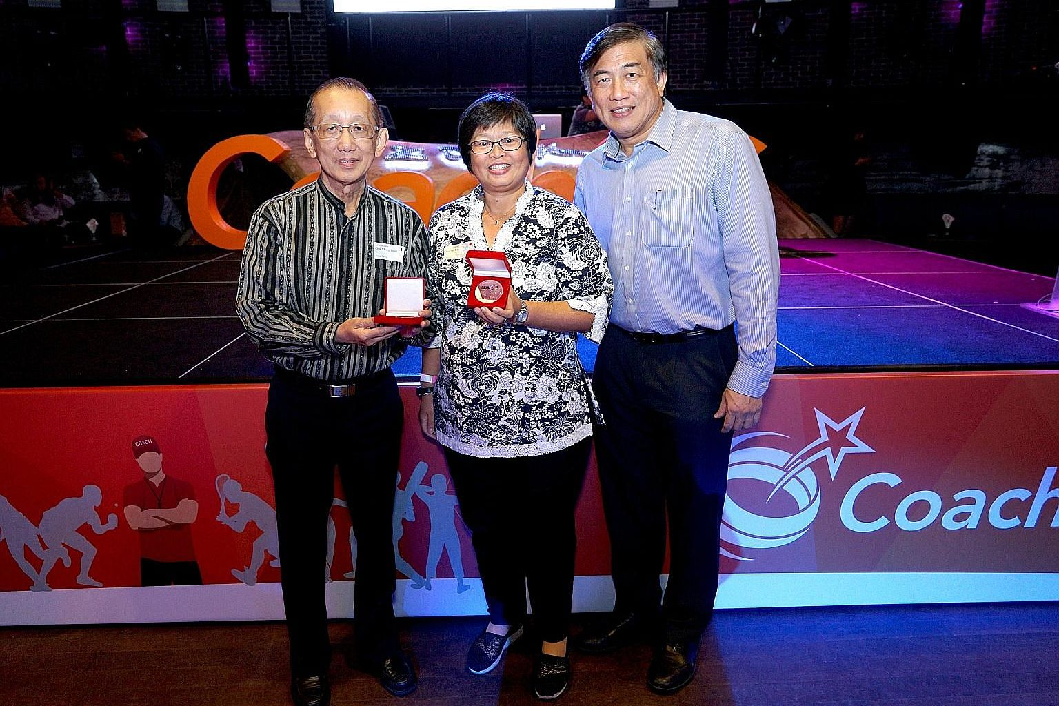 Former table tennis coach Chia Chong Boon and archery coach Rachel Sng were among 105 coaches recognised at the inaugural Coaches Appreciation Night. With them is SportSG CEO Lim Teck Yin.