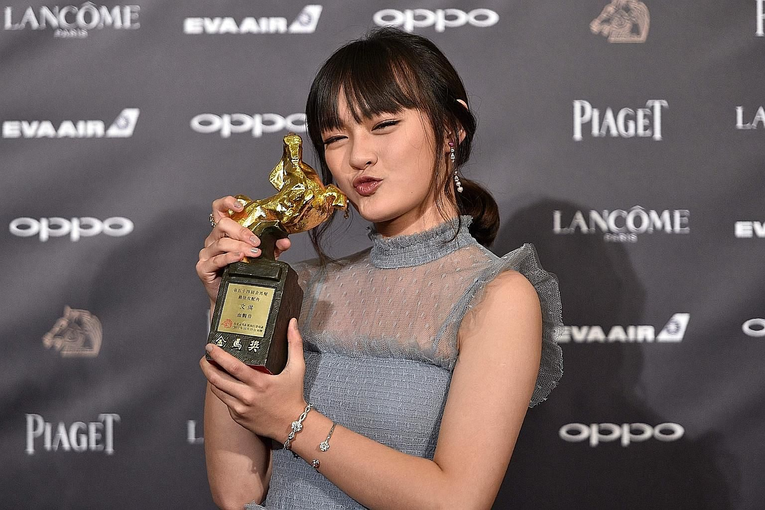 Taiwanese actress Vicky Chen with the Best Supporting Actress award at the Golden Horse Awards in Taipei yesterday.