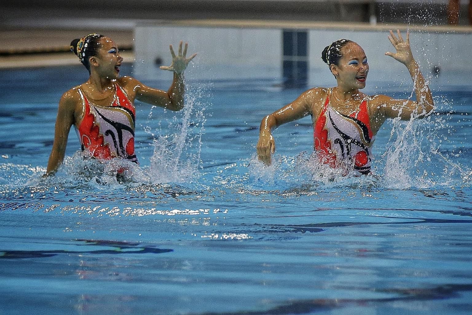 Singapore Swimming Association's Hannah Chiang (left) and Rachel Thean turning on the style to win the open duet free routine final on the last day of National Synchronised Swimming Championships.