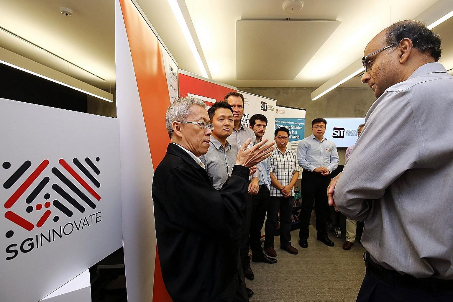 Deputy Prime Minister Tharman Shanmugaratnam with NUS Entrepreneurship Centre director Wong Poh Kam, who is also a professor at NUS Business School, and other SGInnovate partners at the launch of SGInnovate last year. SGInnovate will manage a part of