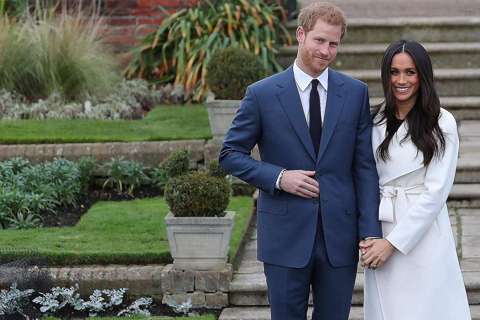 Prince Harry and Ms Meghan Markle at Kensington Palace after the announcement of their engagement on Monday. The engagement is only the latest chapter in the modernisation of the British monarchy.