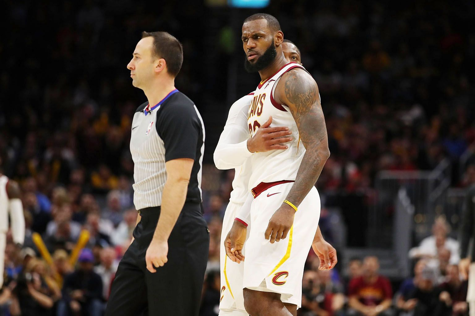 Cleveland Cavaliers' LeBron James, who had 21 points, 12 rebounds, six assists and five steals, arguing with referee Kane Fitzgerald after being ejected near the end of the third quarter against the Miami Heat at Quicken Loans Arena.