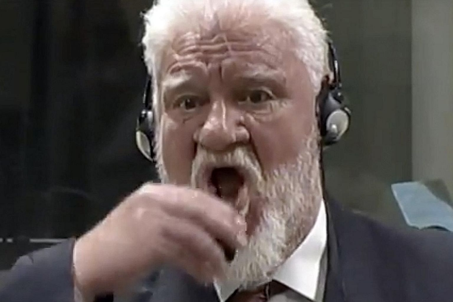Slobodan Praljak seeming to swallow poison in court after judges sentenced him to 20 years in prison for war crimes, at The Hague, Netherlands, on Wednesday.