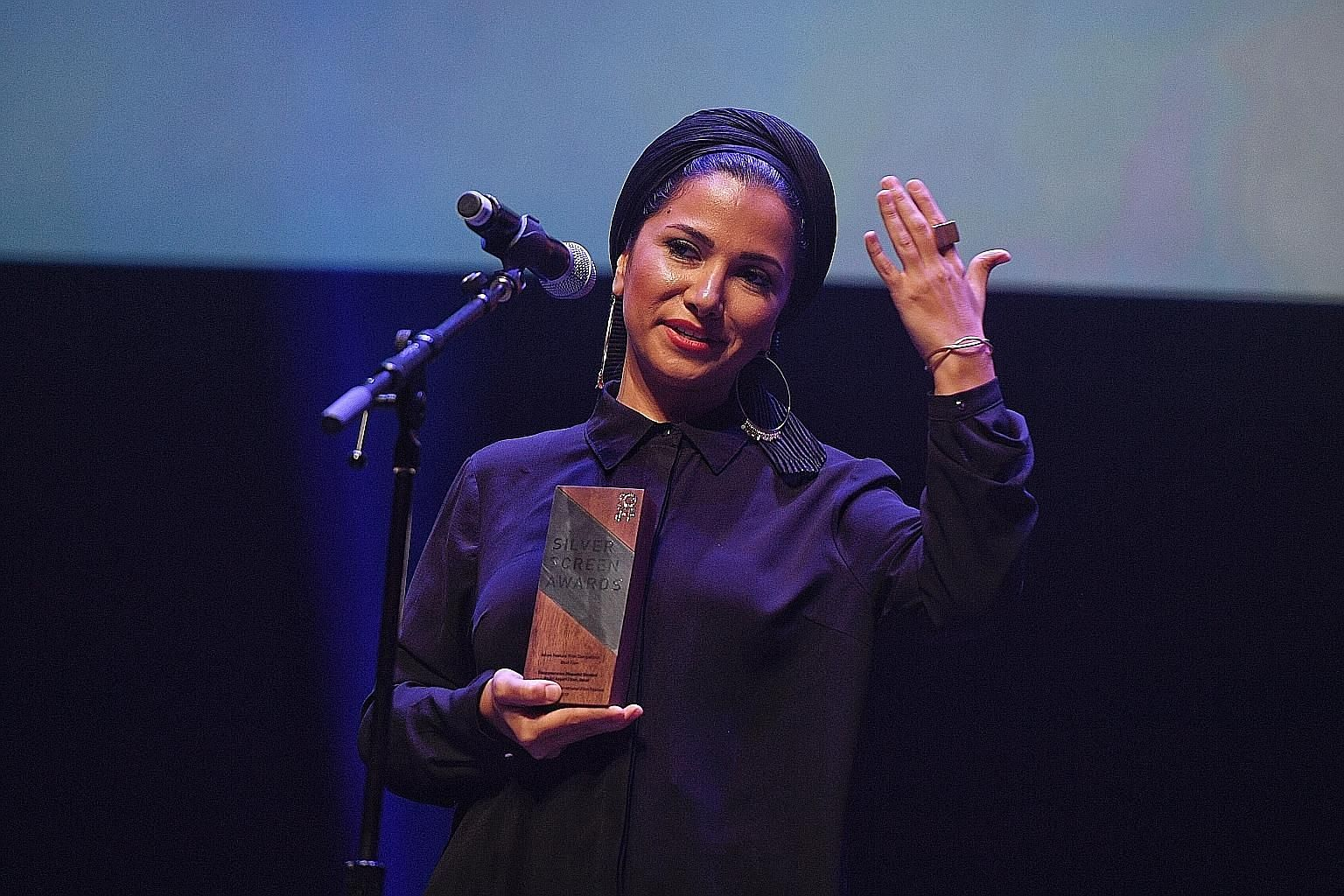 Screenwriter Farnoosh Samadi collecting the award for Iranian movie Disappearance (Napadid Shodan) by Ali Asgari, which won the top accolade of Best Film in the Asian Feature Film category. Actress Sadaf Asgari won the Best Performance award.