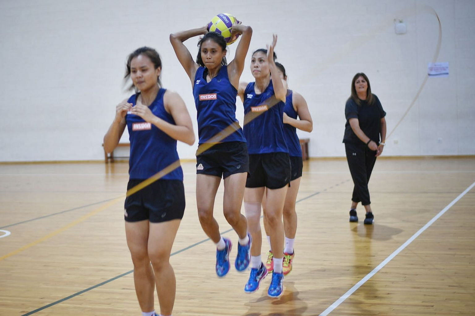 Singapore co-vice captain Nurul Baizura (with ball) and her team-mates training as coach Natalie Milicich draws the rope.