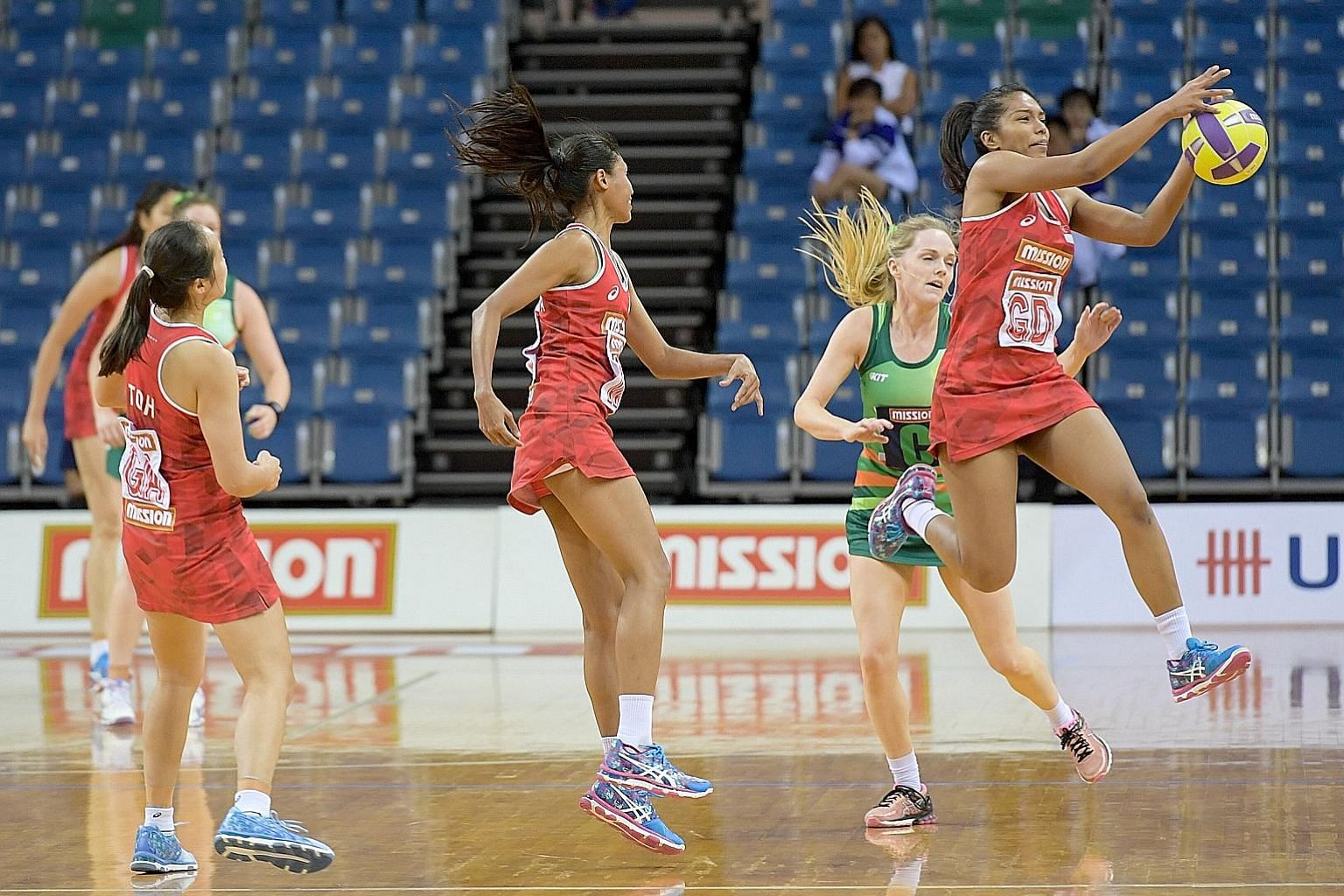 Singapore's goal defender Aqilah Andin in possession during the opening netball match of the Mission Foods Nations Cup at the OCBC Arena yesterday. World No. 19 Singapore lost 53-54 to 22nd-ranked Ireland, after the latter fought back from a third-qu