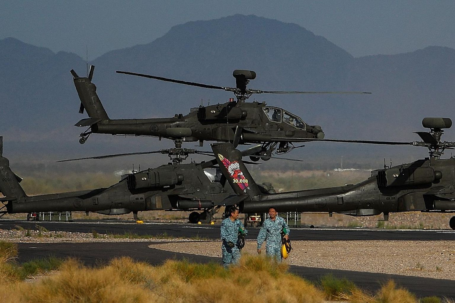 Apache helicopters taking off at Gila Bend Air Force Auxiliary Field in Arizona on Monday during the Forging Sabre exercise. The 16-day live-firing exercise, which began on Nov 28, features upgrades to weapon systems and involves a record 800 personn