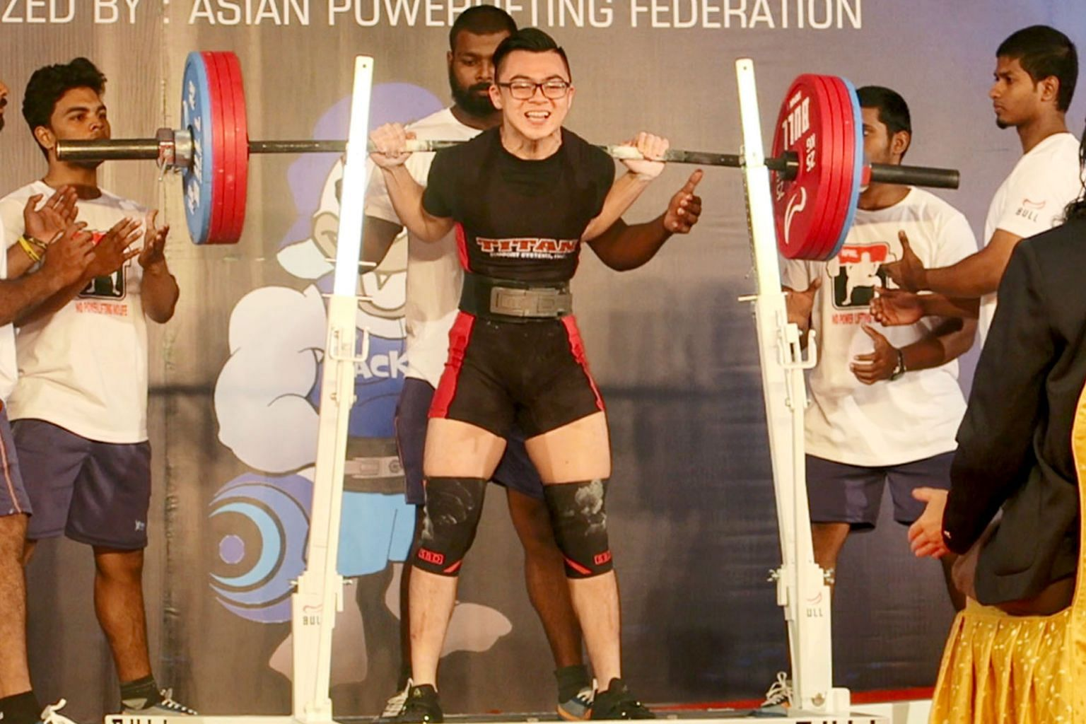 Matthew Yap, 18, broke his own squat (above) world mark twice and also bested Swede Eddie Berglund's total world record.