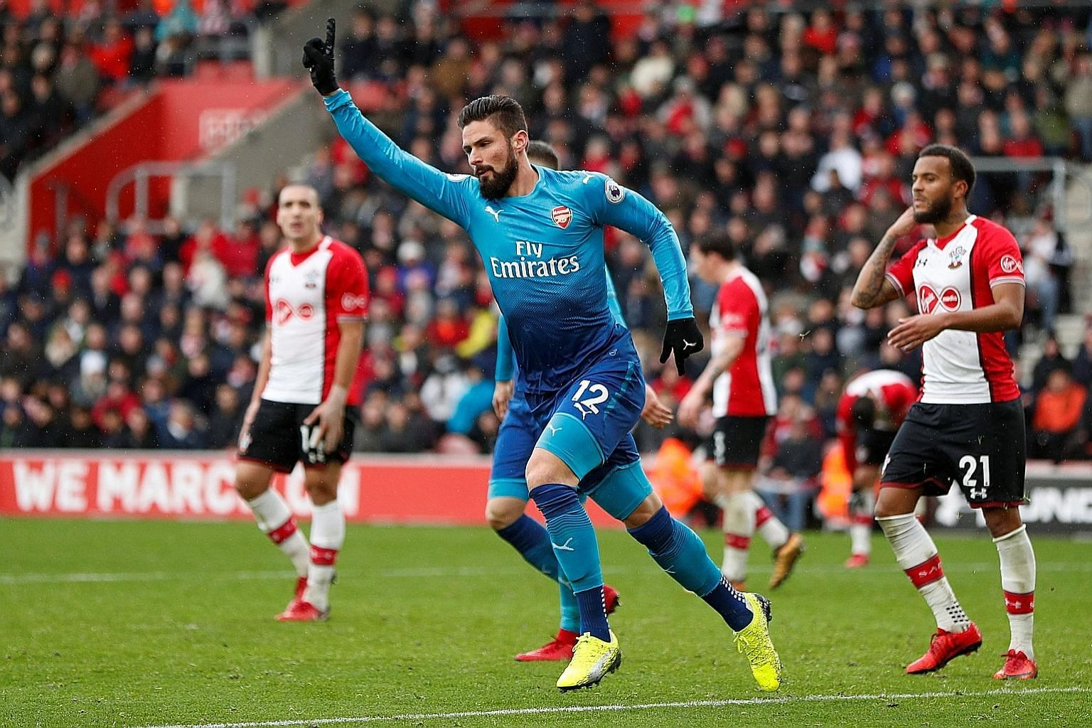 Arsenal's Olivier Giroud celebrates after scoring the 88th-minute equaliser in the 1-1 draw against Southampton yesterday.