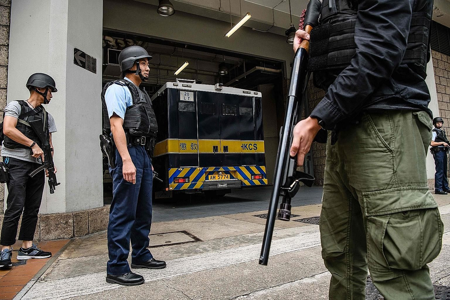Hong Kong police on guard as a prison van drives Briton Rurik Jutting into the High Court for his appeal hearing yesterday.