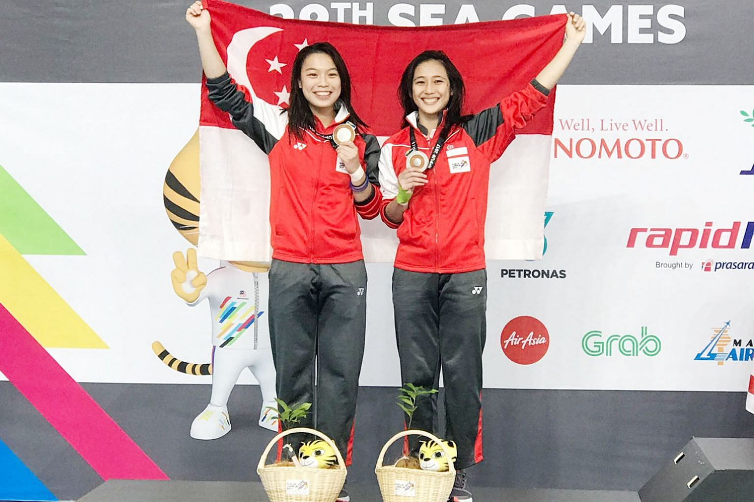Singapore's 3m springboard synchronised duo of Ashlee Tan (left) and Fong Kay Yian after winning SEA Games silver in Kuala Lumpur in August. A failed drug test has elevated them to champions.