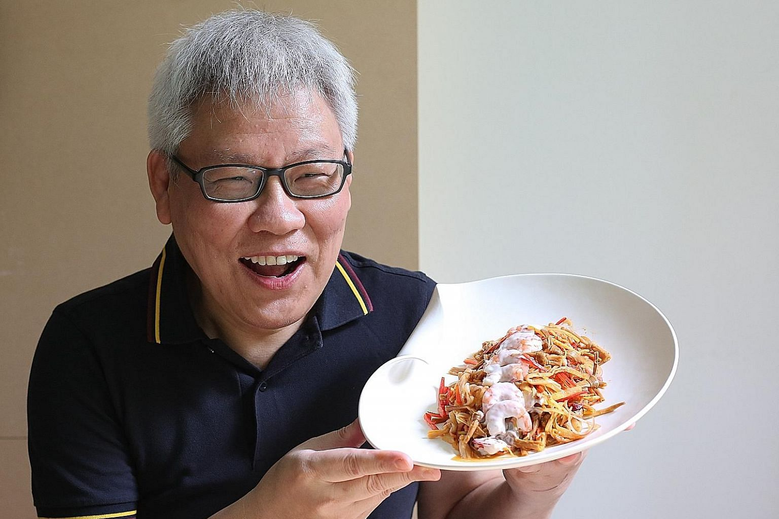 Lloyd Matthew Tan with his sambair kim chiam (dried lily bud salad with coconut cream) - a recipe from his late mother.