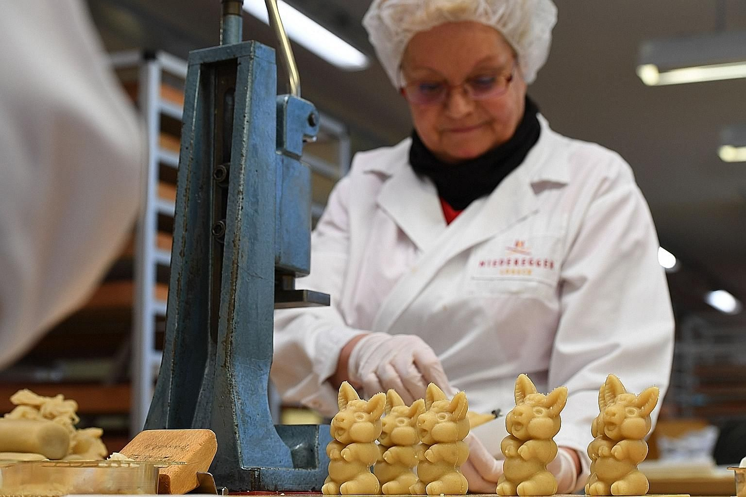 An employee of traditional confectionery maker JG Niederegger preparing pigs made of fresh marzipan in Luebeck, Germany. For Germans, no Christmas is complete without marzipan, the sugar and almond treat that dates back to the Middle Ages. Market pre