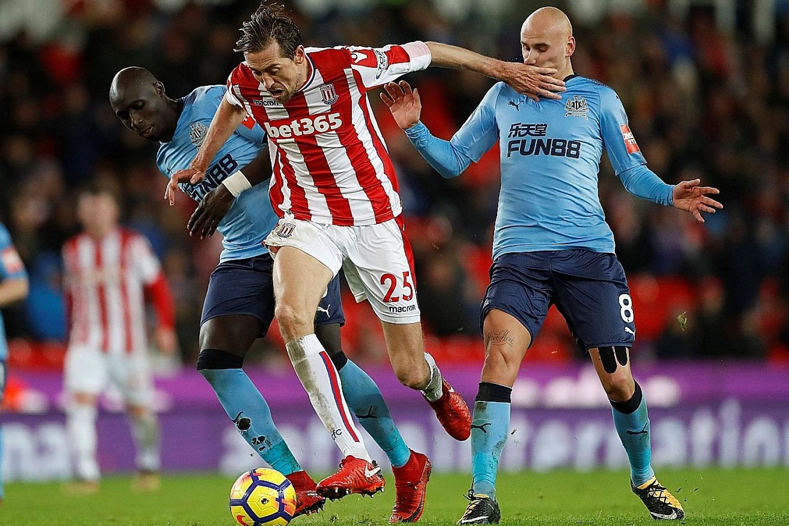 Newcastle's Mohamed Diame (far left) and Jonjo Shelvey trying to rob Stoke's Peter Crouch of the ball. Mark Hughes' decision to field a weakened team at Chelsea and bring back his senior players for Newcastle backfired as they lost both games.