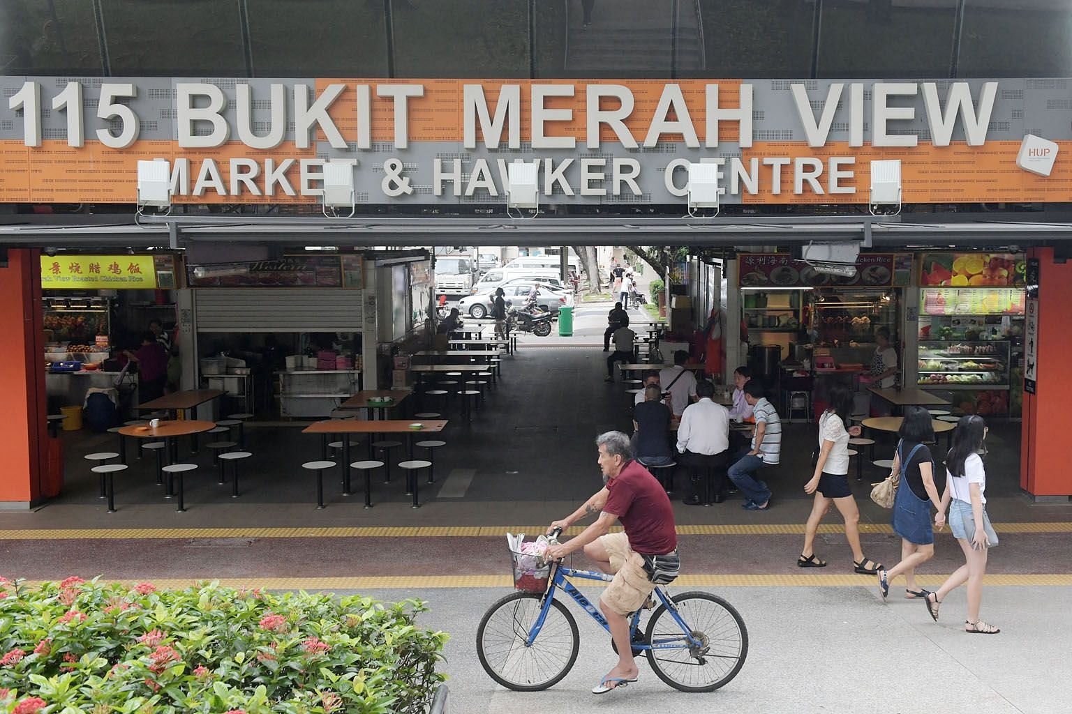 Madam Mung Kuai Ho, 87, having breakfast at the revamped hawker centre. Its reopening means she can return to her much-loved routine of eating there. The newly reopened market and hawker centre has widened walkways, accessibility ramps, slip-resistan