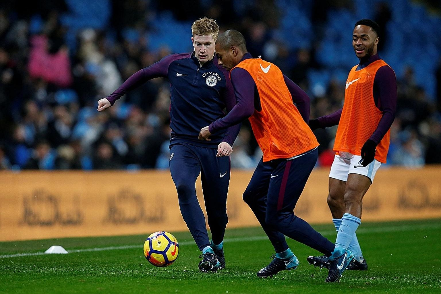 From left: Manchester City's Kevin de Bruyne, Fernandinho and Raheem Sterling warming up before the 3-1 win over Watford on Tuesday. Manager Pep Guardiola has insisted he will not take the visit of Burnley lightly and all three stars are expected to