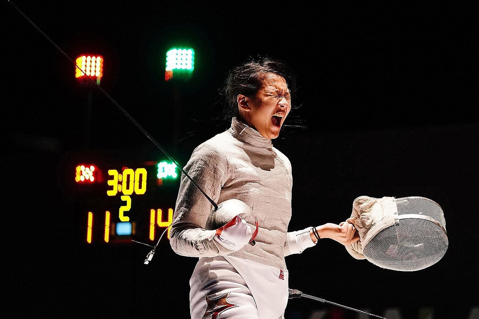 Lau Ywen letting off a victory cry after beating Vietnam's Bui Thi Thu Ha in the individual sabre semi-finals at the SEA Games in Kuala Lumpur last August. She went one better by overcoming Thailand's Pornsawan Ngernrungruangroj in the final.