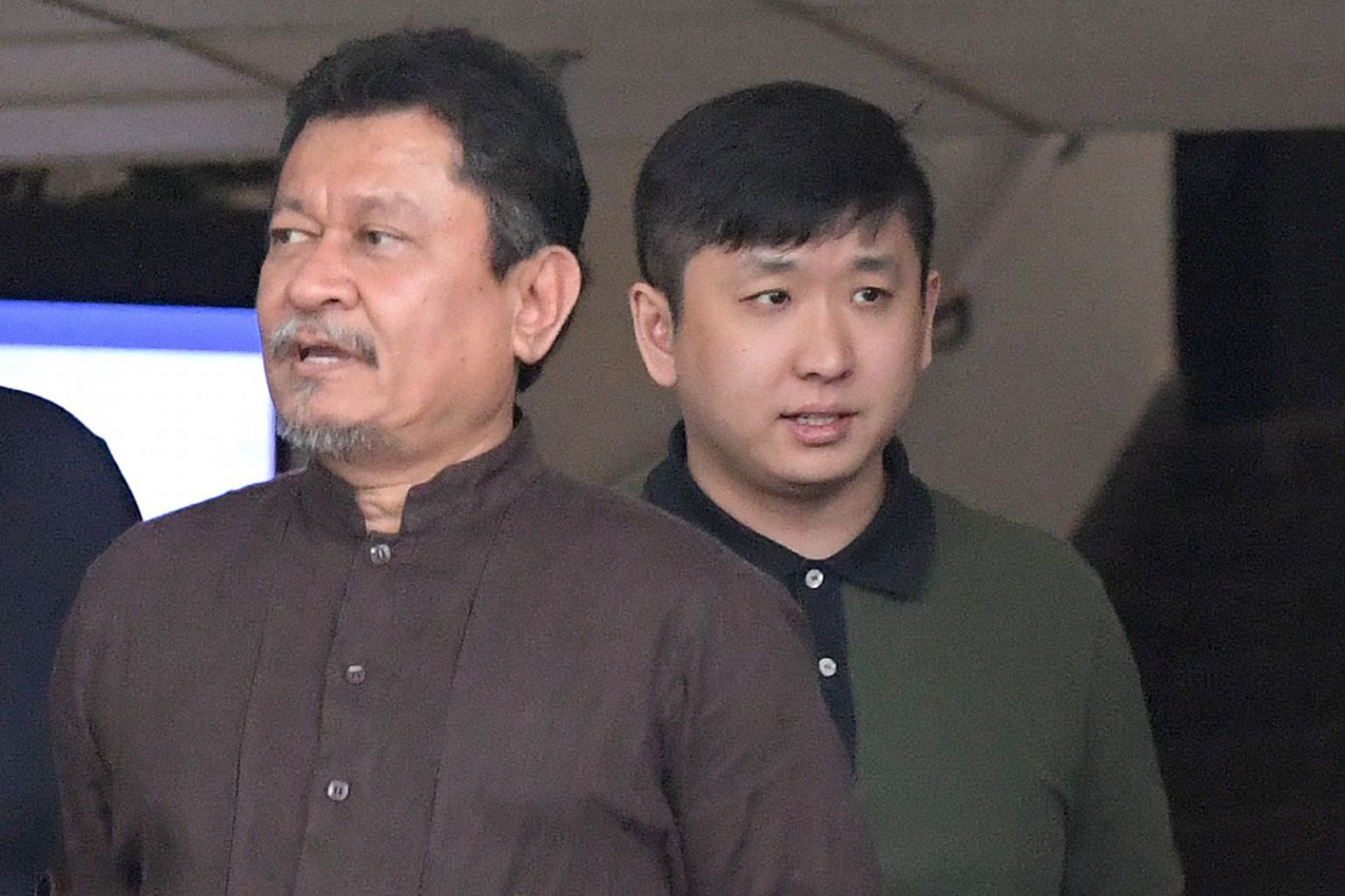 """Trading firm An-Nahl's director Abdul Nagib Abdul Aziz (left) and retail firm Synnex Trading's director Jia Xiaofeng face charges that they """"wilfully infringed"""" copyright by helping people access pirated content."""