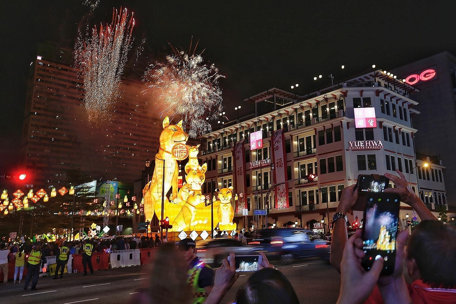 Above: Prime Minister Lee Hsien Loong launched this year's Chinese New Year celebrations in Chinatown last night, kick-starting 49 days of festivities. Top: Fireworks lighting up the sky in Chinatown.