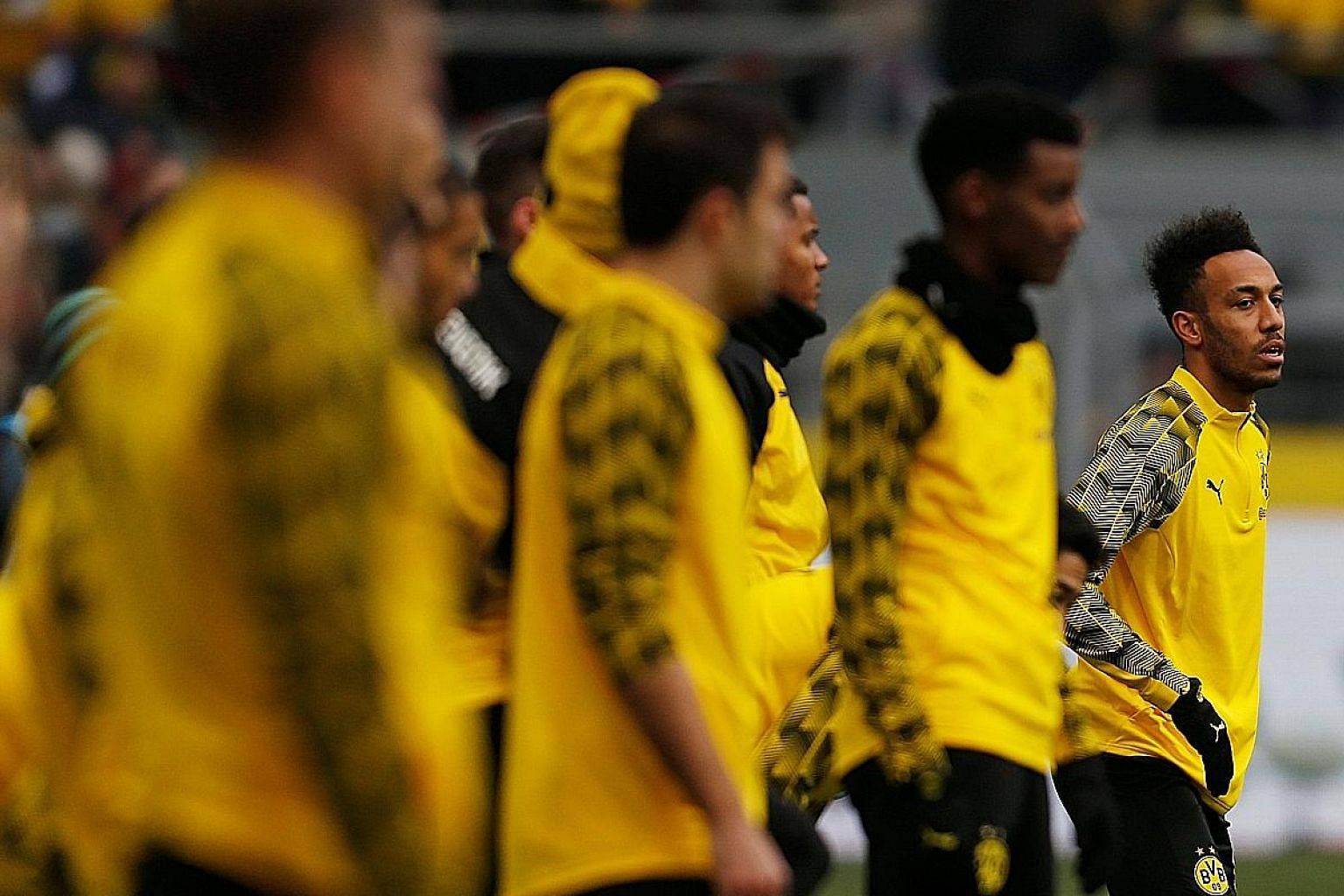 The transfer of Pierre-Emerick Aubameyang (far right) to Arsenal will not be ratified by Borussia Dortmund until they find a replacement for the Gabon striker.