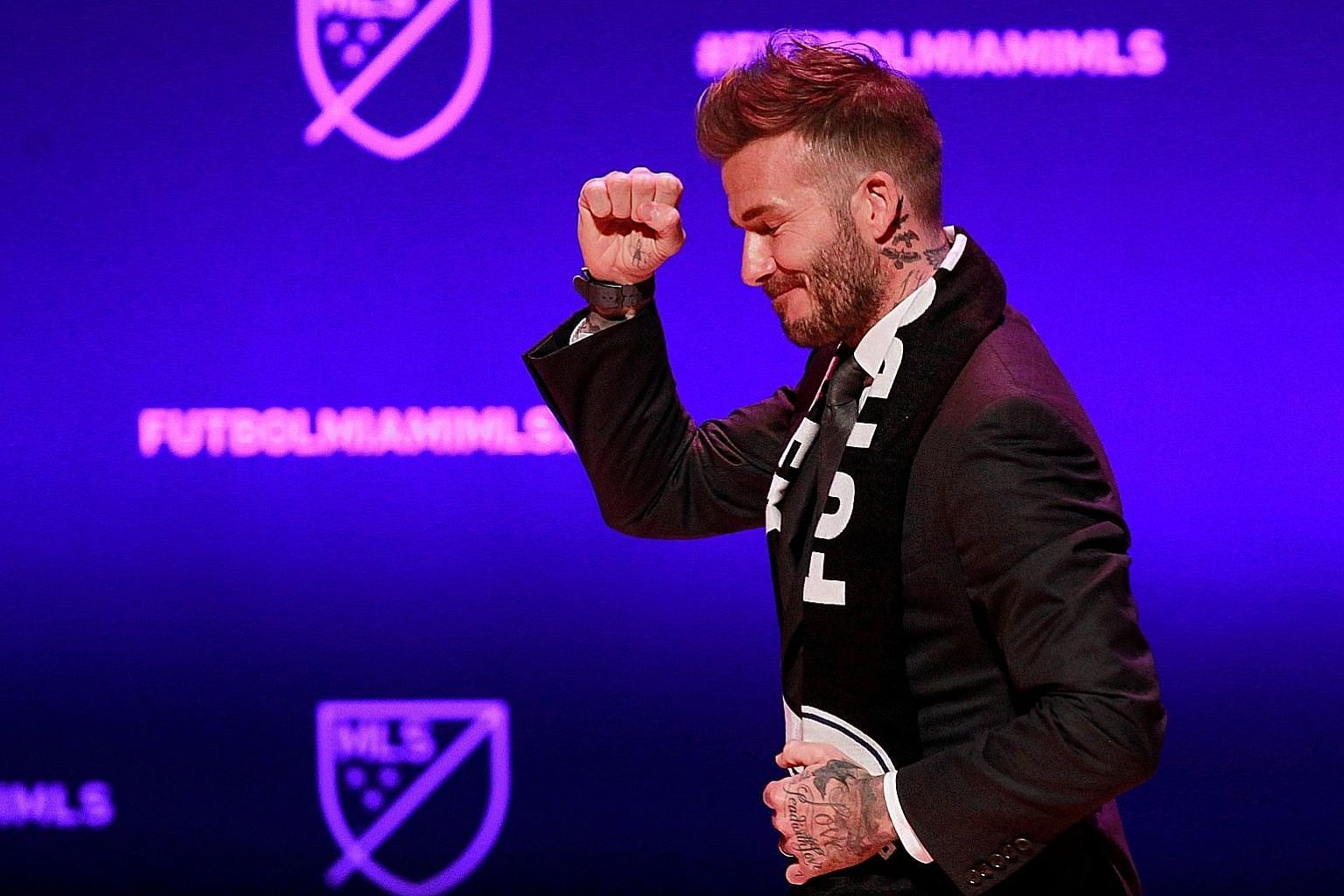 David Beckham salutes the crowd at the launch of his Major League Soccer team in Miami, after four years of wrangling over a stadium site.