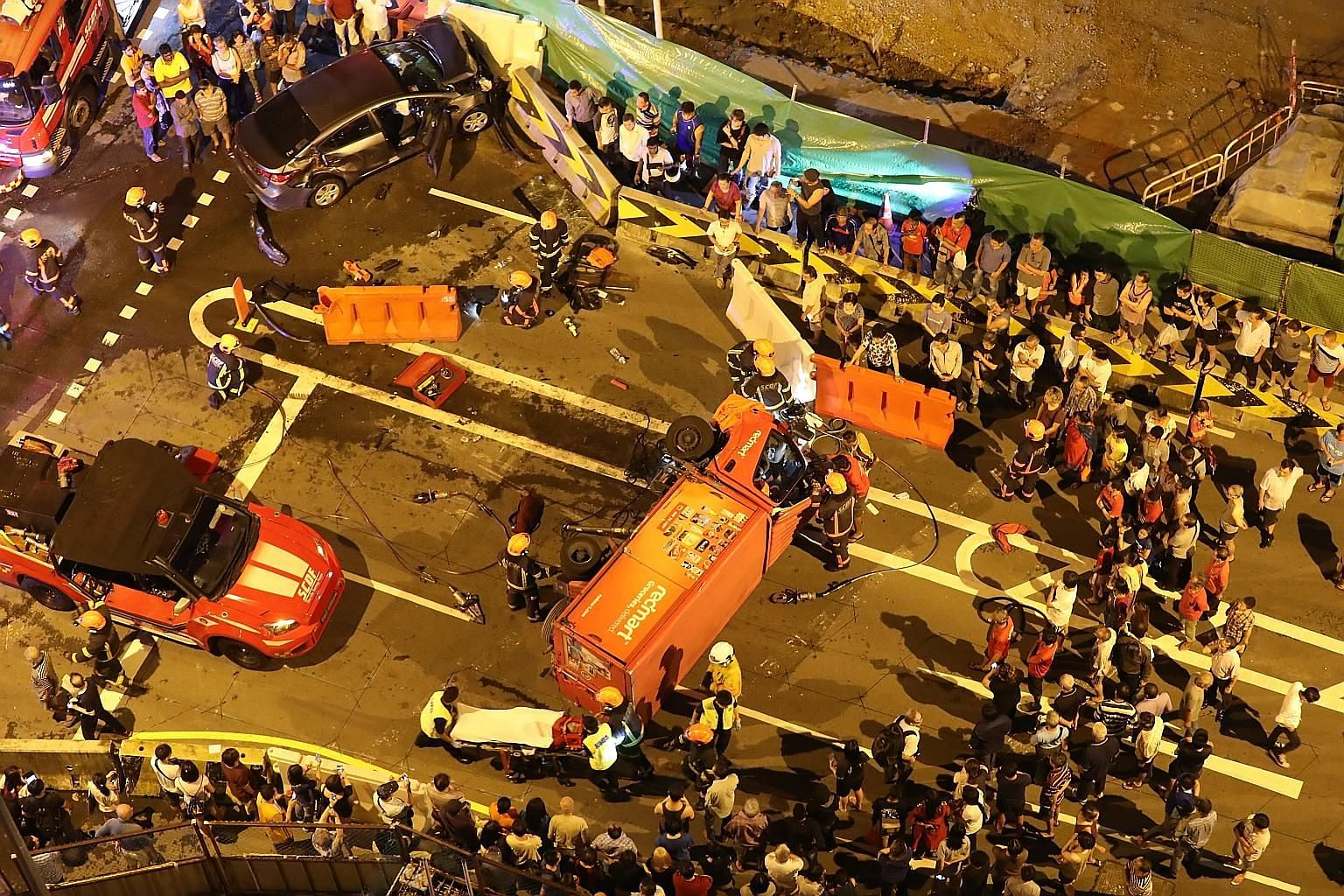 The crash between the Redmart lorry and car occurred at the junction of Ang Mo Kio Avenue 4 and Ang Mo Kio Street 11 at about 10pm. SCDF officers extricated the driver trapped in the lorry using hydraulic tools and took him to Tan Tock Seng Hospital.