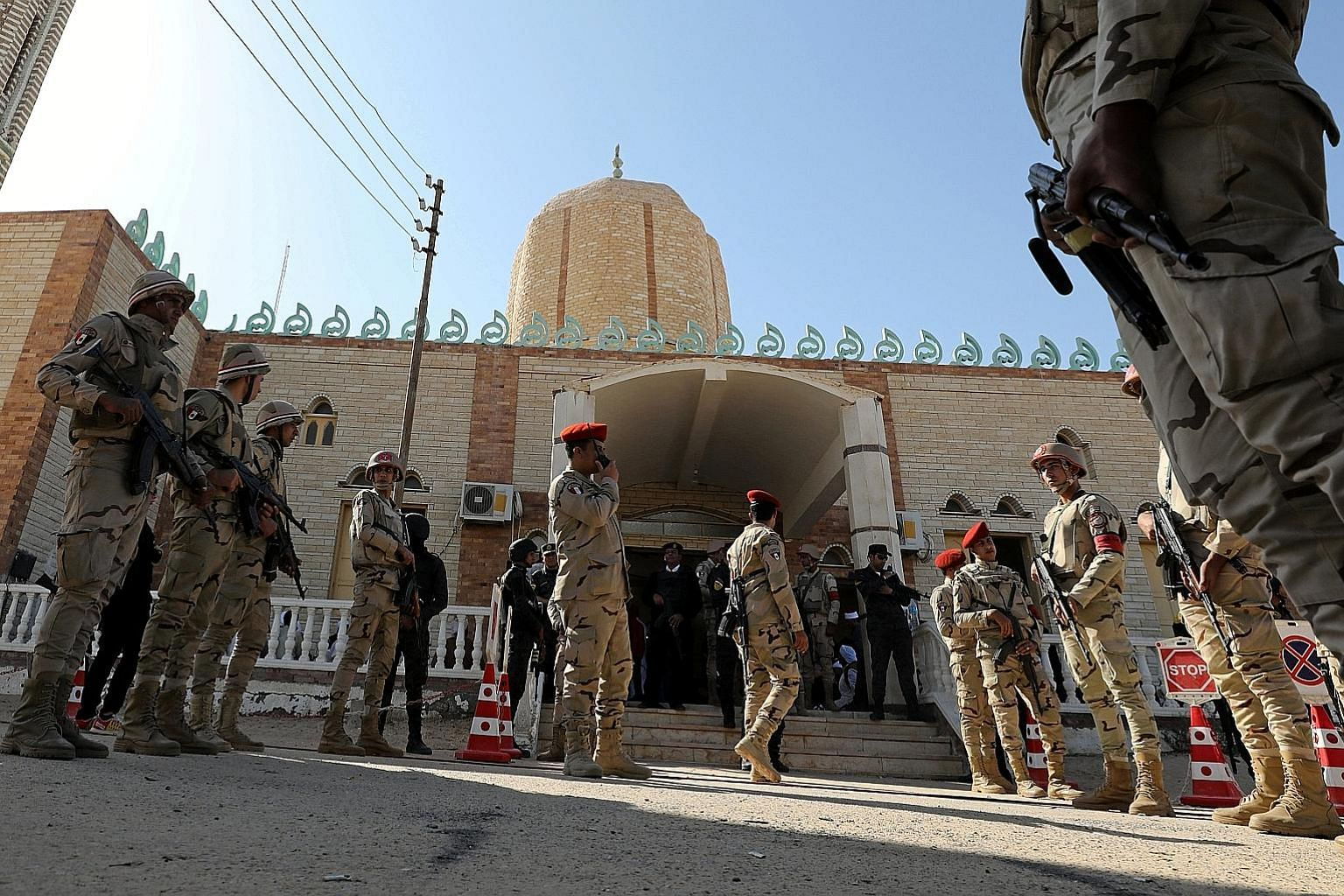 Military security members patrolling outside the Al Rawdah mosque after a terror attack in Bir Al-Abed, in the North Sinai, Egypt, last year. Egypt and Israel are now secret allies in a covert war against a common foe - the militants - after being en