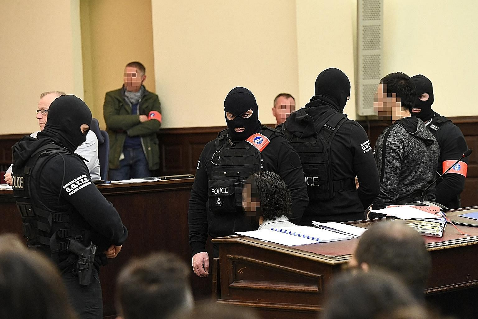 Salah Abdeslam, the prime surviving suspect in the November 2015 terror attacks on Paris, in court in Brussels yesterday. The trial relates only to the March 2016 shoot-out with police in the southern Brussels borough of Forest. Citing his right to s