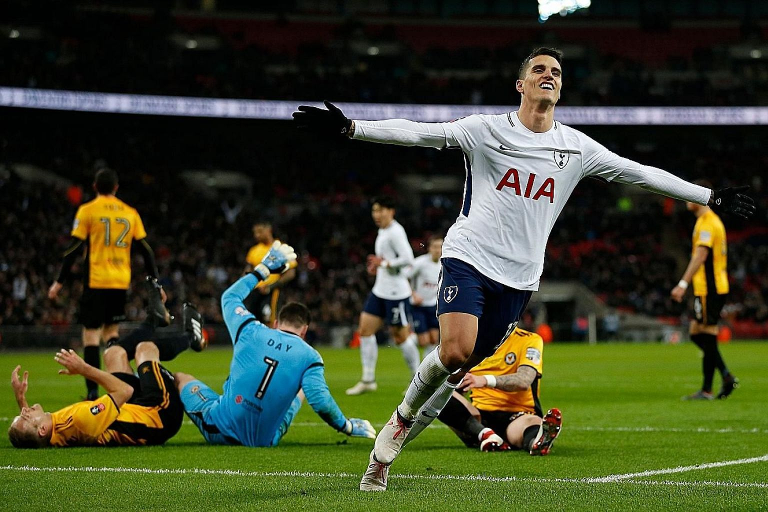 Midfielder Erik Lamela, whose hip injury kept him out for over a year, wheeling away after scoring Spurs' second goal against Newport in the FA Cup replay on Wednesday.