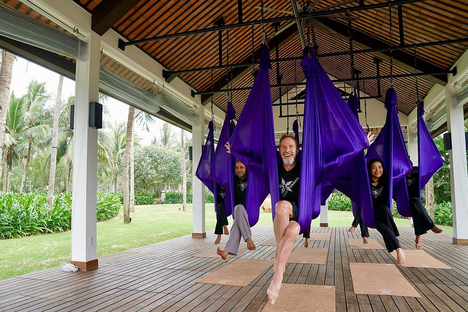 Four Seasons Resort The Nam Hai offers anti-gravity yoga sessions.