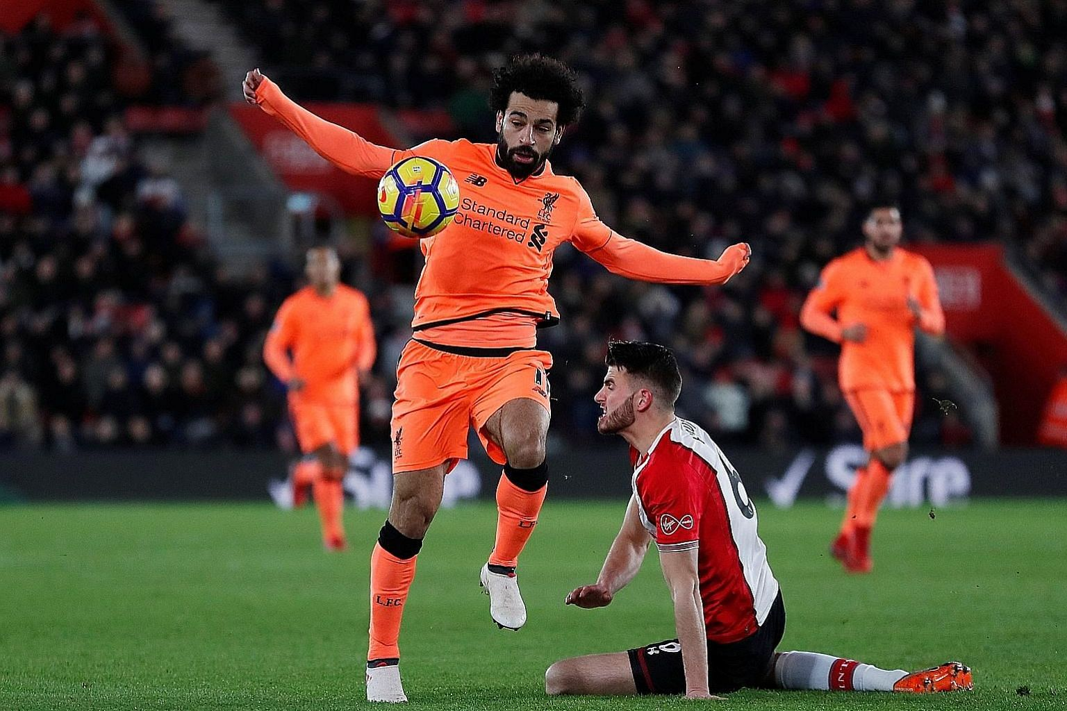 Liverpool's Mohamed Salah getting the better of Southampton defender Wesley Hoedt on Sunday. Salah pounced on an error by Hoedt to set up the opening goal before scoring his 22nd Premier League goal of the season.