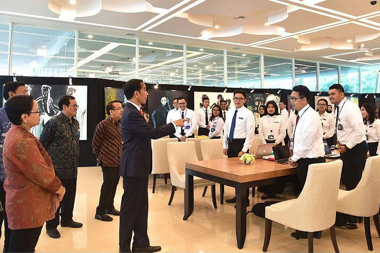 Indonesia's President Joko Widodo with (from left) Foreign Minister Retno Marsudi, Coordinating Security Minister Wiranto (partly hidden), Cabinet Secretary Pramono Anung and State Secretariat Minister Pratikno yesterday urged his diplomats to do mor