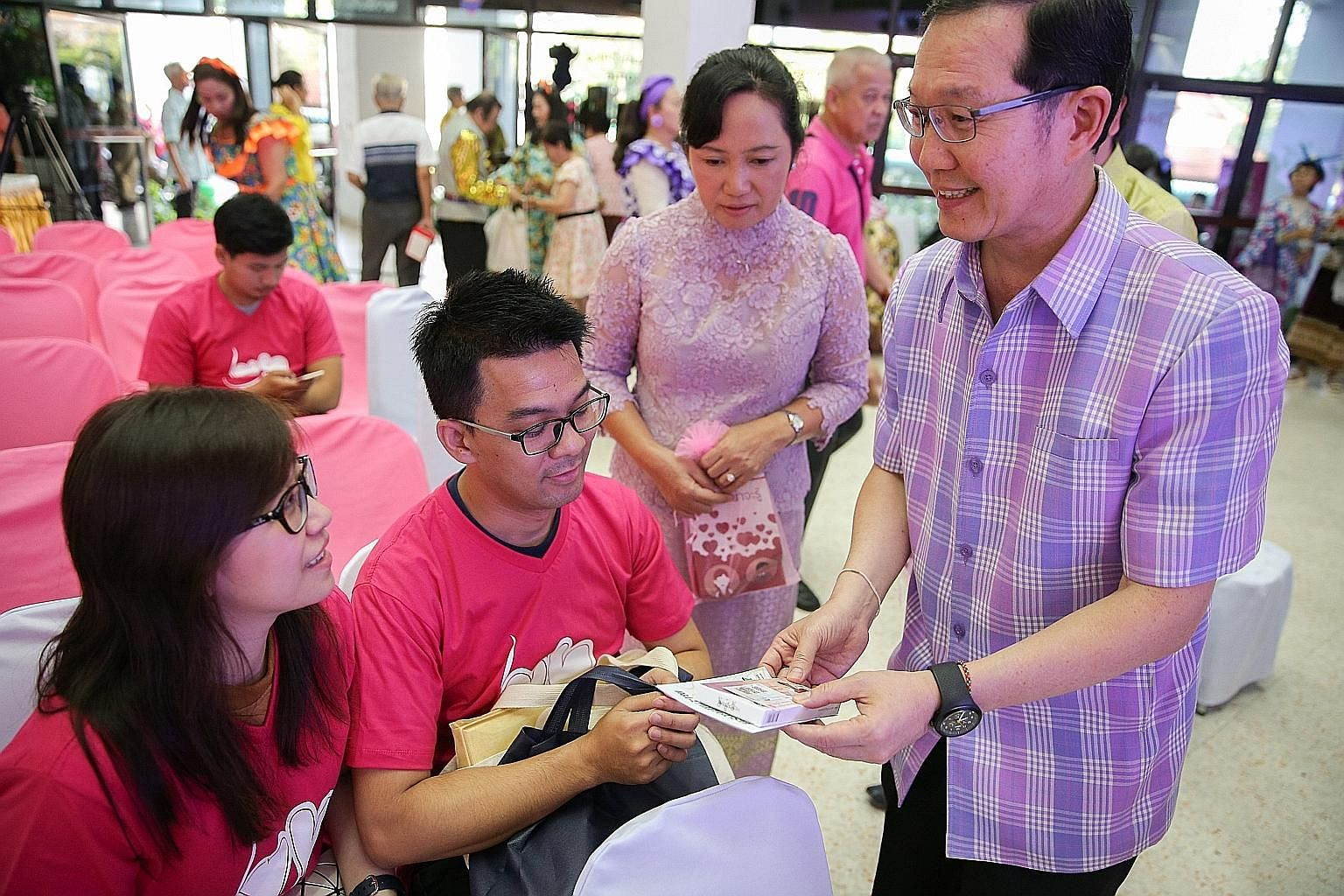 A public health officer giving vitamins to a couple at a Valentine's Day celebration in Bangkok yesterday. Thailand's cash bonuses and tax incentives for people with children have done little to boost births, but analysts said they were not generous