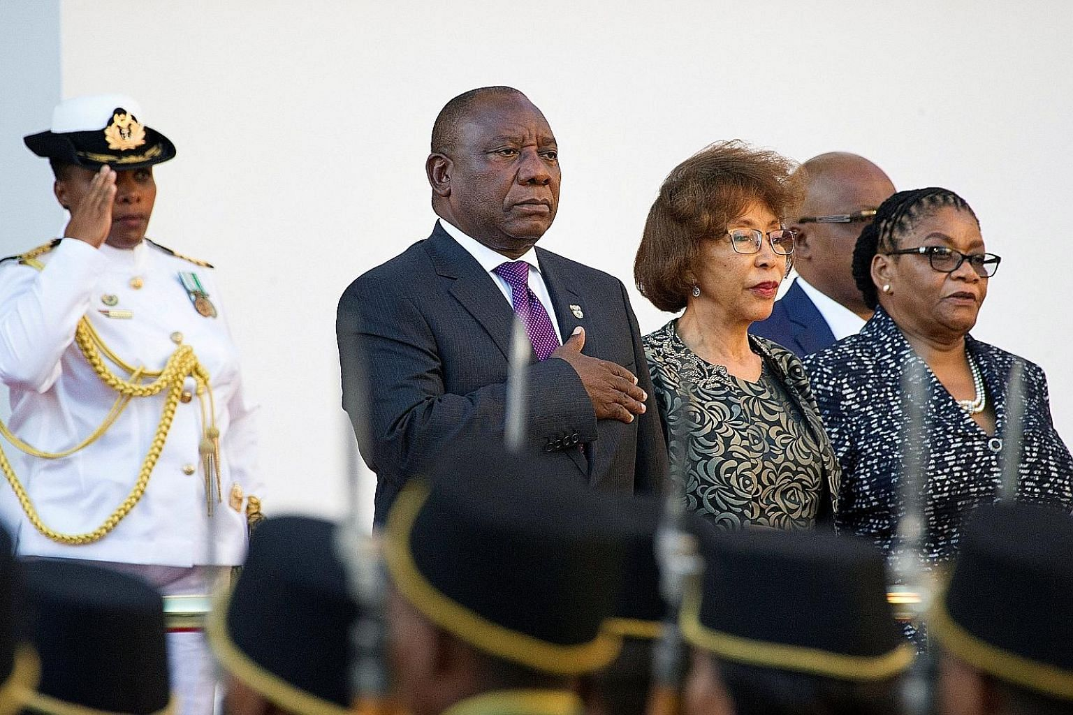 President Cyril Ramaphosa taking part in the national salute as he arrives to deliver his State of the Nation address in Cape Town on Friday. Among his most pressing priorities will be to select a deputy president and reshuffle the Cabinet.