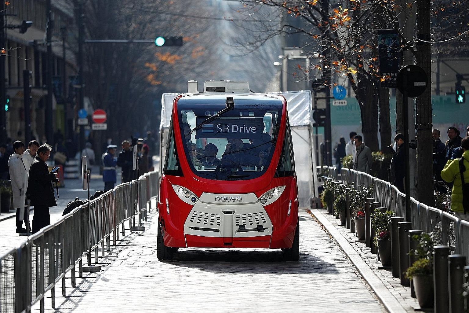 A self-driving bus in Japan. Even as the number of autonomous cars on US roads multiplies, there is still no serious discussion of their shortcomings, says the writer who identifies five key problems.