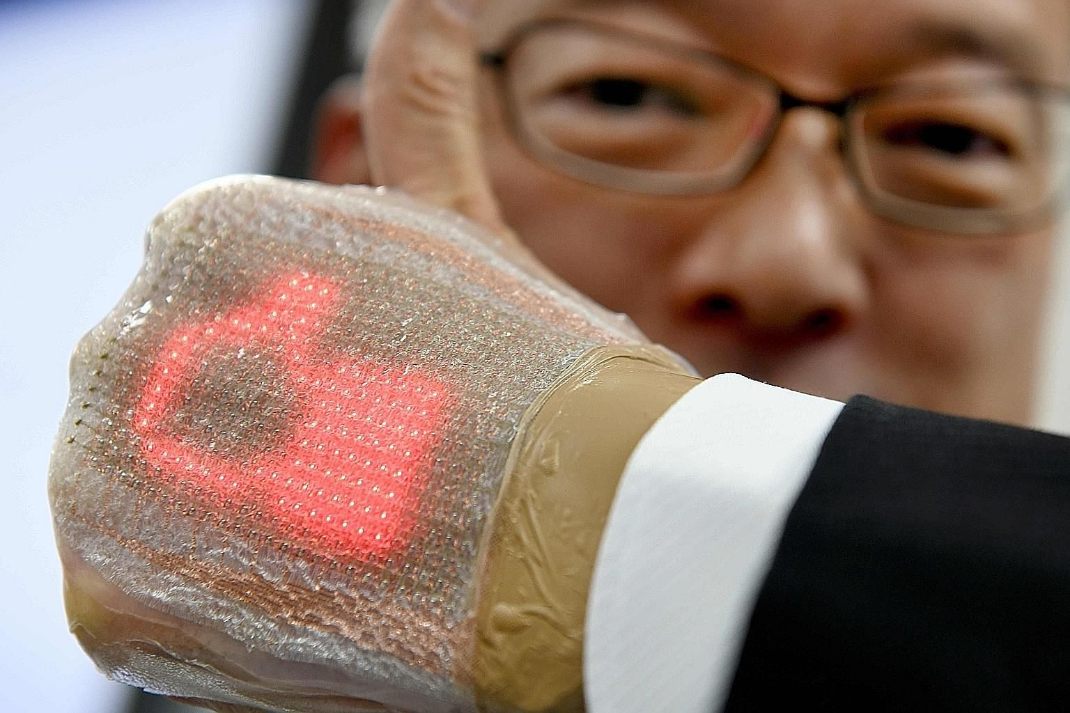 The device, developed by University of Tokyo's Professor Takao Someya, is only 1mm thick and can send and receive messages, including emojis. The plaster-like invention can be placed on the human body for a week without causing skin inflammation.